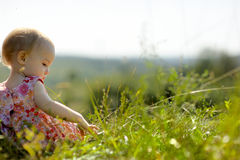 Baby girl on the edge of a cliff Royalty Free Stock Photo