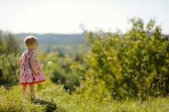 Baby girl on the edge of a cliff Stock Photo