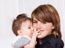 Baby girl embracing her mother Royalty Free Stock Photos