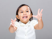 Baby girl with emotional temper. With gray background Royalty Free Stock Photo