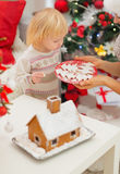 Baby girl enjoying Christmas cookies Royalty Free Stock Photo
