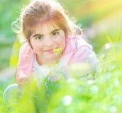 Baby girl enjoying flowers Stock Images
