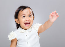 Baby girl excite with hand up. With gray background Stock Images