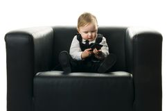 Baby girl on executive chair Royalty Free Stock Photo