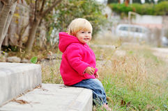 Baby girl in fall Royalty Free Stock Image