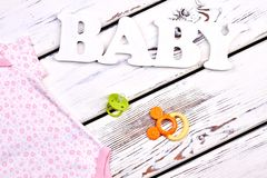Baby-girl fashion apparel, accessories. Stock Photos