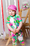 Baby girl in a fashionable suit, cap Royalty Free Stock Images