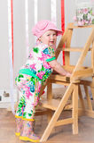 Baby girl in a fashionable suit, cap Royalty Free Stock Photos