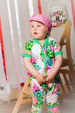 Baby girl in a fashionable suit, cap Royalty Free Stock Image