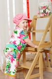 Baby girl in a fashionable suit, cap Stock Photography