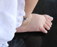 Baby girl feet Stock Images