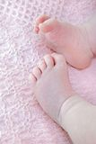 Baby girl feet on blanket Stock Photography