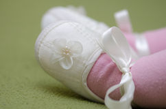 Baby  girl feet and shoes Royalty Free Stock Images