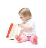 The baby girl finds a present royalty free stock photo