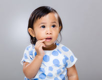Baby girl finger touch mouth Royalty Free Stock Images