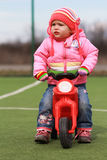 Baby girl and first bike Stock Photography