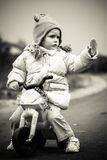Baby girl and first bike Royalty Free Stock Photo