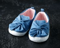 Baby girl first blue denim shoes with bow stock photo