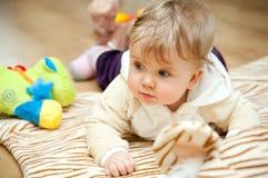 Baby girl on floor Royalty Free Stock Photo