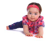 Baby girl on the floor looking at camera Royalty Free Stock Photos