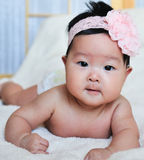Baby girl with flower Royalty Free Stock Photos