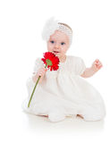 Baby girl with flower gift stock image