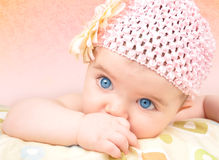 Baby Girl with Flower Hat Stock Image