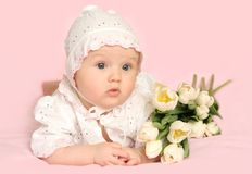 Baby girl with flowers. Newborn (3 months Stock Photo