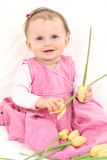 Baby girl with flowers Royalty Free Stock Photography