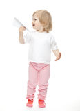 The baby girl is flying a paper plane royalty free stock photography