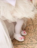 Baby girl footwear at first birthday party Stock Image