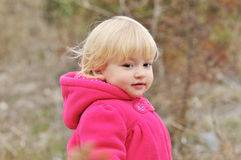 Baby girl in the forest Royalty Free Stock Images