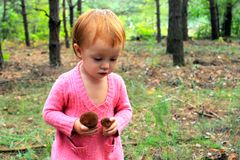 Baby girl in the forest Royalty Free Stock Image
