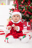 Baby girl in front of christmas tree Royalty Free Stock Photography