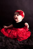 Baby girl in full red skirt Royalty Free Stock Image