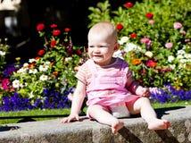 Baby girl in the garden Stock Photo