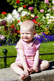 Baby girl in garden Stock Images