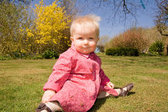 Baby girl garden flowers Royalty Free Stock Images