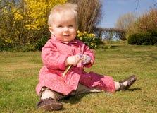 Baby girl garden flowers Stock Photos