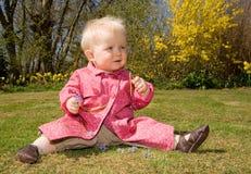 Baby girl garden flowers Stock Images