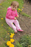 Baby girl in the garden Royalty Free Stock Photos