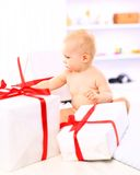 Baby girl with gift boxes Royalty Free Stock Photo