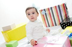Baby girl with gifts. Isolated on white background Stock Photography