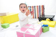 Baby girl with gifts Stock Image
