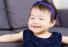 Baby girl giggle. Little asian baby girl smile Stock Photo