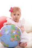 Baby girl with globe Royalty Free Stock Photos