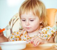 Baby girl is going to eat Stock Photo