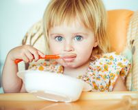 Baby girl is going to eat Stock Images