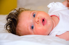 Baby girl. Gorgeous baby girl laying on the bed Royalty Free Stock Images
