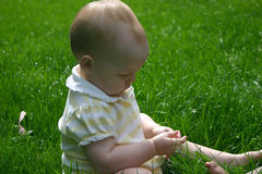 Baby girl on grass Royalty Free Stock Images